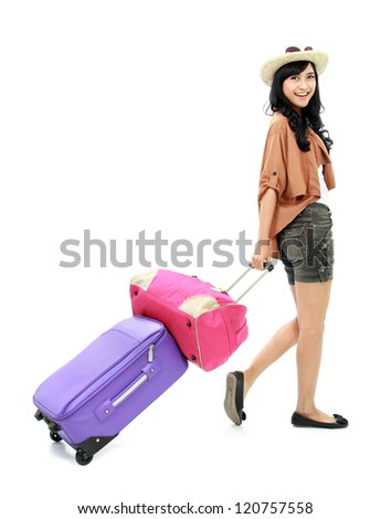 portrait of Happy girl going on vacation walking with suitcase and smile - stock photo