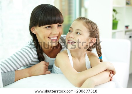 Portrait of happy girl looking at her mother - stock photo