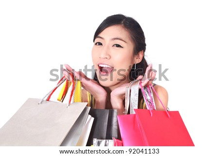 Portrait of happy girl shopping over white background