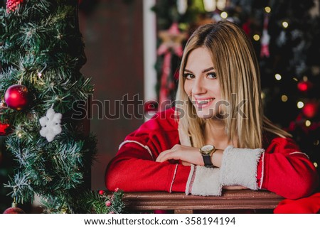 Portrait of happy girl teenager. In the background the Christmas decorations - stock photo