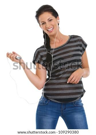 Portrait of happy girl with headphones listening music - stock photo