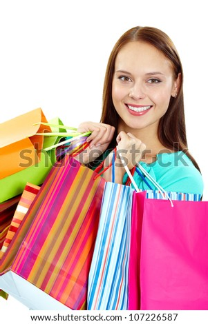 Portrait of happy girl with paperbags after shopping