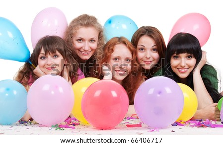 portrait of happy girls with balloons lying on the floor