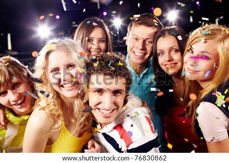 Portrait of happy glamorous friends in a night club - stock photo