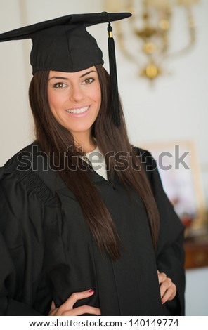 Portrait Of Happy Graduate Young Woman, Indoors - stock photo