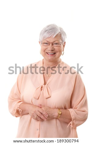 Portrait of happy grandmother looking at camera. - stock photo
