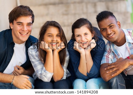 portrait of happy highschool students outdoors - stock photo