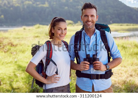 Portrait of happy hikers, backpackers couple - stock photo