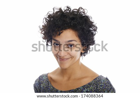 Portrait of happy hispanic girl smiling confident at camera