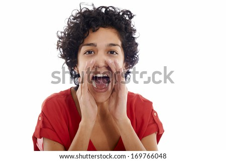 Portrait of happy hispanic woman screaming and shouting at camera