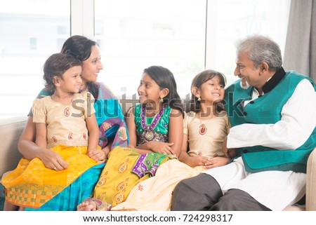 Portrait of happy Indian family bonding at home. Asian parents and children indoors lifestyle.