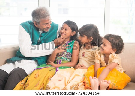 Portrait of happy Indian family having fun at home. Asian father and children indoors lifestyle.