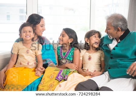 Portrait of happy Indian family having fun at home. Asian parents and children indoors lifestyle.