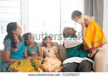 Portrait of happy Indian family playing at home.