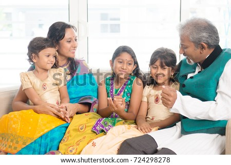 Portrait of happy Indian family relax at home. Asian people indoors lifestyle.