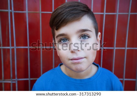 Portrait of happy joyful beautiful little boy against a red background - stock photo