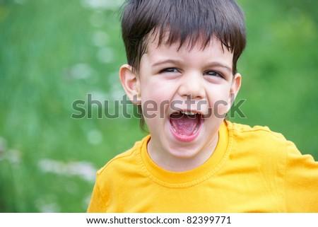 Portrait of happy joyful beautiful little boy in summertime - stock photo