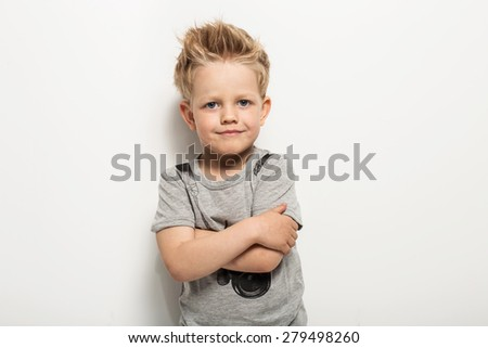 Portrait of happy joyful beautiful little boy. Studio portrait over white background  - stock photo
