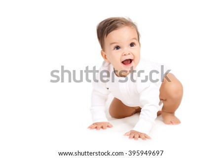 Portrait of happy laughing baby in white bodysuit. Portrait of sitting down small child Isolated on white. baby, child, kid