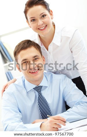 Portrait of happy leaders looking at camera with smiles - stock photo