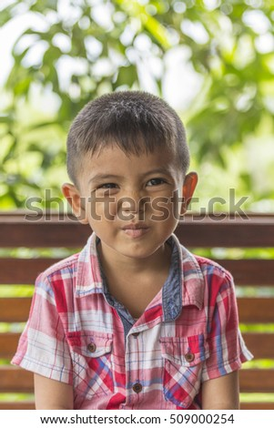 Portrait of happy little Asian boy looking at camera