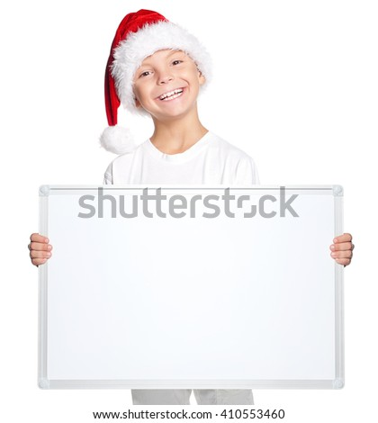 Portrait of happy little boy in Santa hat with blank board, isolated on white background - stock photo