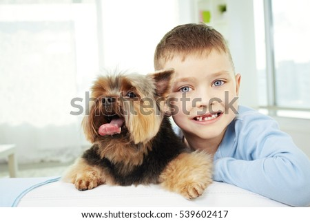 Portrait of happy little boy with his dog