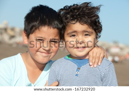portrait of happy little brothers outdoors - stock photo