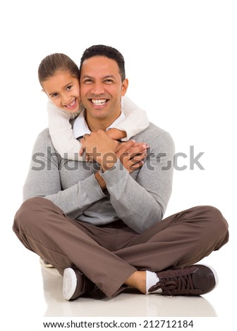 portrait of happy little girl hugging her father - stock photo