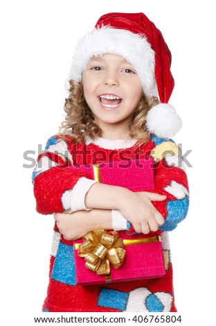 Portrait of happy Little girl in pajamas and santa hat with gift box isolated on white background - stock photo
