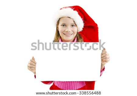 Portrait of happy little girl in Santa hat with white blank board. Isolated on white background