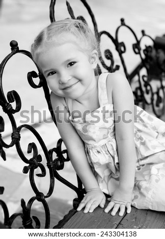 portrait of happy little girl in the summer  ( black and white ) - stock photo