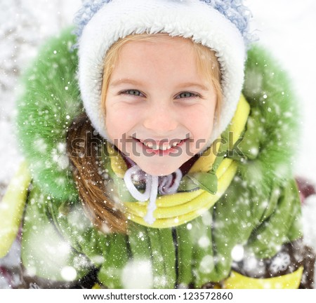 Portrait of happy little girl winter vacation - stock photo