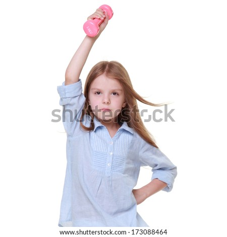 Portrait of happy little girl with dumbbells isolated on white background