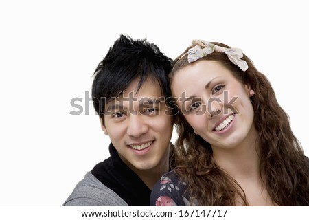 Portrait of happy loving couple over white background