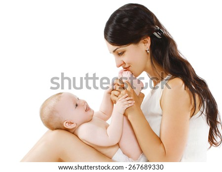 Portrait of happy loving mother playing with cute baby  - stock photo