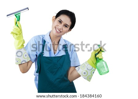 Portrait of happy maid hotel holding cleaning tools - stock photo