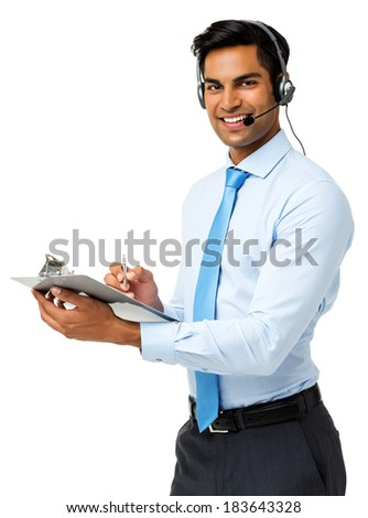Portrait of happy male call center representative writing on clipboard against white background. Vertical shot. - stock photo