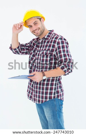 Portrait of happy male repairman wearing hard hat while holding clipboard over white background - stock photo