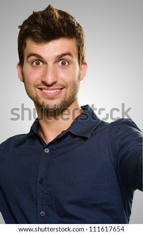 Portrait Of Happy Man Isolated On Grey Background