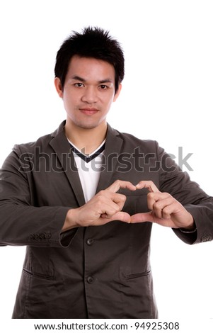 Portrait of happy man making heart sign - stock photo