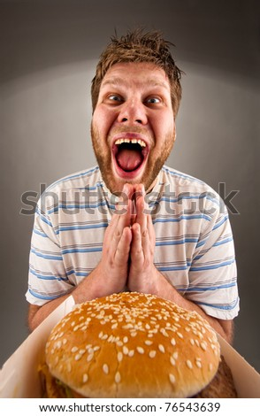 Portrait of happy man praying for fast food - stock photo