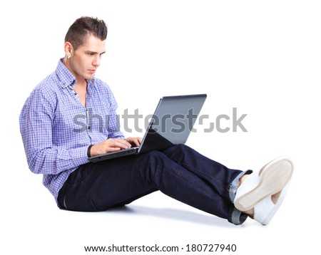 Portrait of happy man working on laptop in casuals - isolated on white. Concept communication.