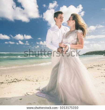 Portrait of happy marriage couple at the beach resort hotel grand. Traveling at Thailand, Phuket. Honeymoon summer travel. Phe Phe island with blue sky background