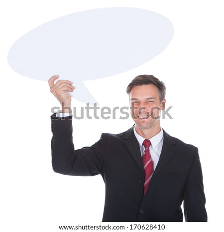 Portrait Of Happy Mature Businessman Holding Thought Bubble - stock photo