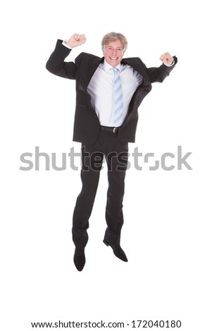 Portrait Of Happy Mature Businessman Raising Arm Over White Background - stock photo