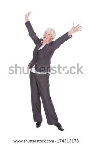 Portrait Of Happy Mature Businesswoman Standing Over White Background - stock photo