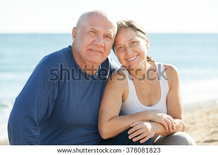 Portrait of happy mature couple at sea vacation