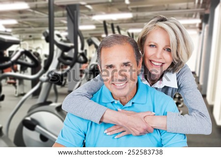 Portrait Of Happy Mature Couple Embracing At Gym - stock photo