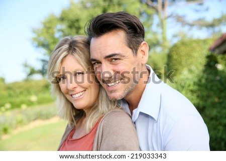 Portrait of happy mature couple in backyard